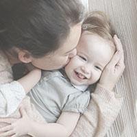Mother kisses toddler